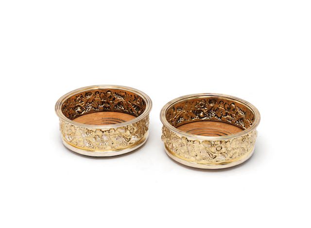 A pair of silver-gilt wine coasters Roberts & Belk, Sheffield 1973 (2)