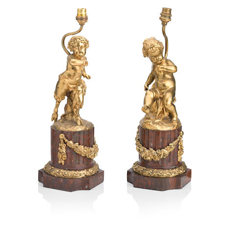 After Clodion, Claude Michel (1738-1814) A pair of gilt bronze figure groups (2)