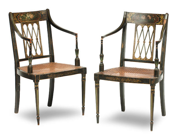 A pair of George III ebonised and floral painted open armchairs (2)