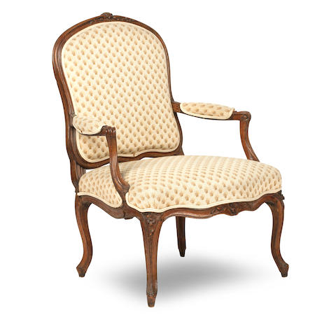 A Louis XV carved beech framed Fauteuil