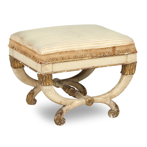 A white painted and carved giltwood Regency stool