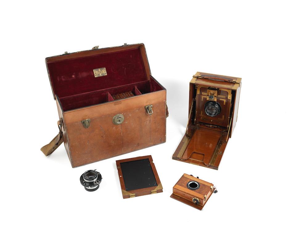 An Adams tropical folding plate camera,  English, early 20th century,  (qty)