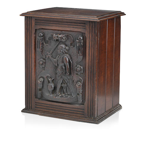 AN 18TH CENTURY AND LATER CARVED OAK CUPBOARD