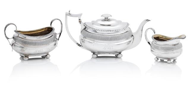 A George III three piece Scottish silver tea service by John Mckay, Edinburgh 1814