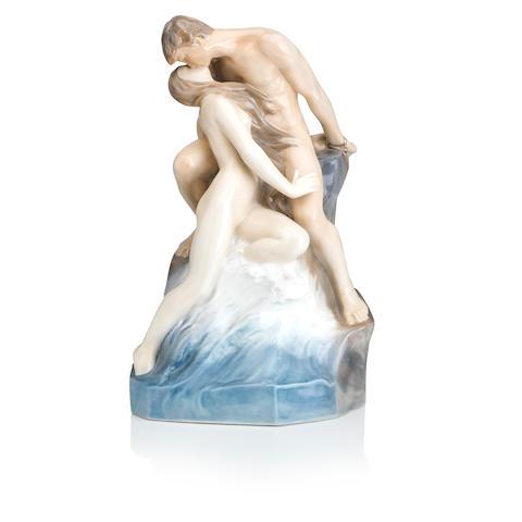 A Royal Copenhagen porcelain figure group 'The Kiss' Introduced 1953