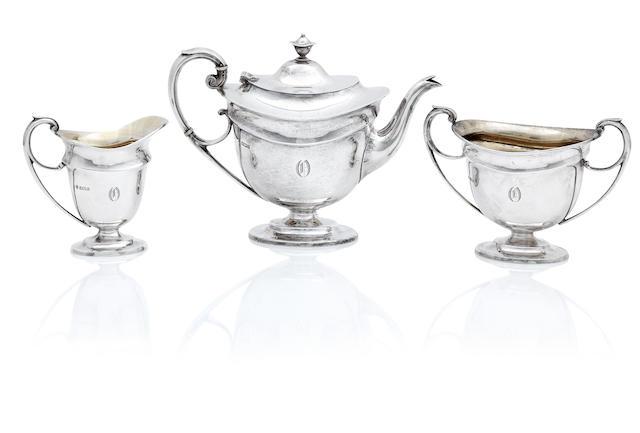 A three piece silver tea service by Martin Hall & Co Ltd, Sheffield 1906/10