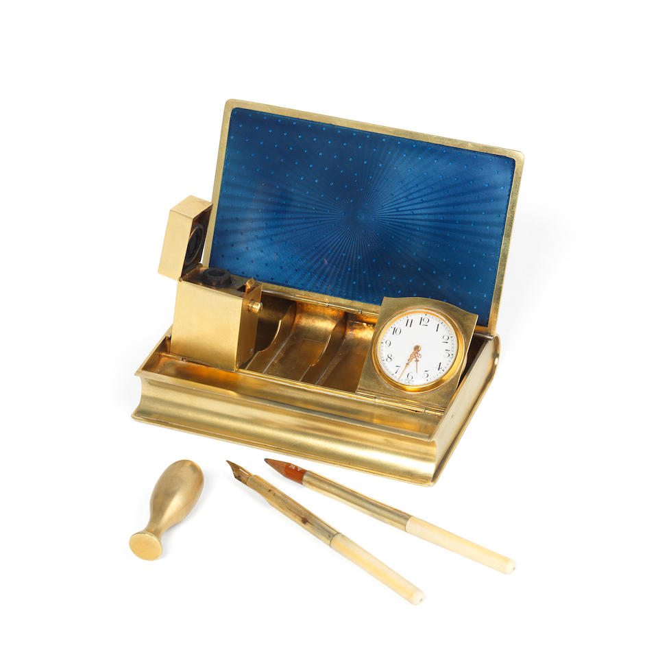 A novelty French silver-gilt and enamel desk compendium Paris circa 1910
