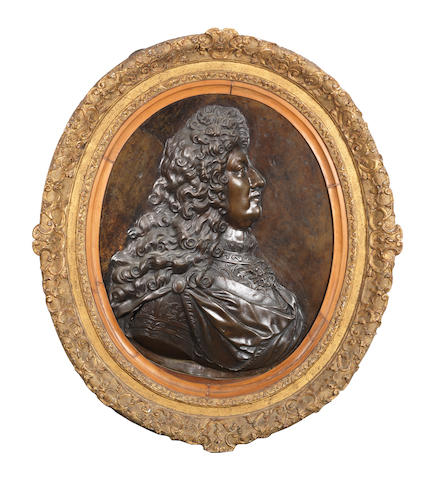 A 19th Century French patinated bronze profile portrait oval relief of Louis XIV in the style of François Girardon (French, 1628 -1715)