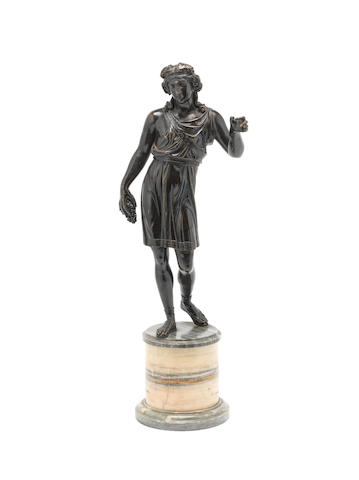 A late 19th/early 20th century patinated bronze figure of a Bacchic youth