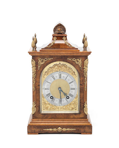 An early 20th century gilt brass mounted walnut mantel clock the movement stamped Lenzkirch
