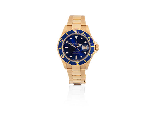 Rolex. An 18K gold automatic calendar bracelet watch   Submariner, Ref: 16618T, Circa 2005