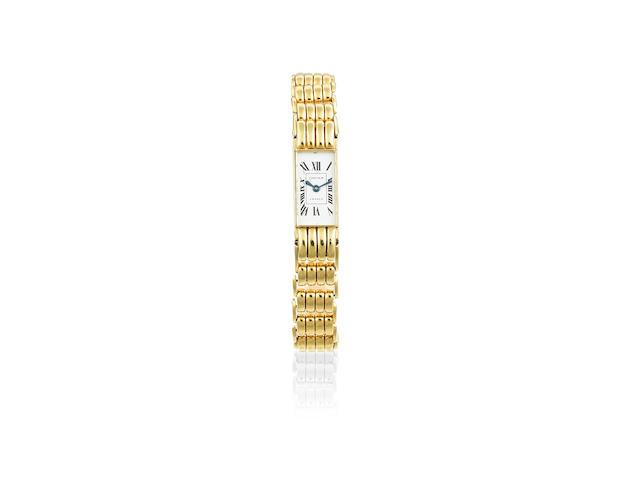 Jaeger-LeCoultre for Cartier. An 18K gold manual wind rectangular bracelet watch  Tank, Circa 1945