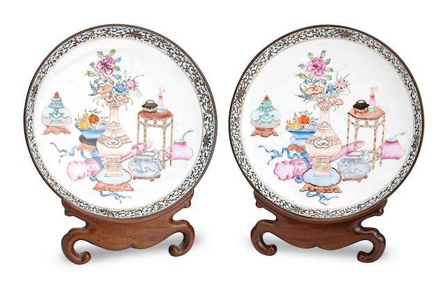 A pair of Canton enamel saucer dishes with wood display stands Qing Dynasty, 19th century