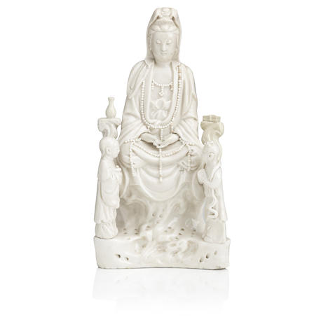 A blanc-de-chine figure of Guanyin and attendants 17th/18th century