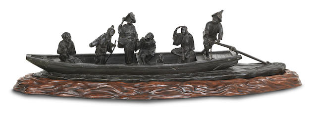 A large and impressive bronze group of figures on a ferry on matching wood stand Meiji Era, unsigned