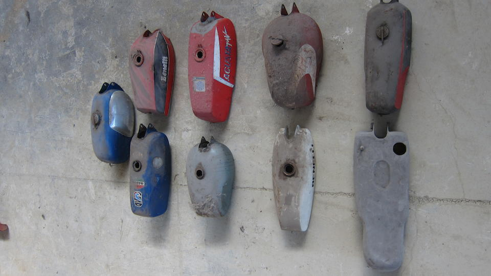 A quantity of petrol tanks  ((9))