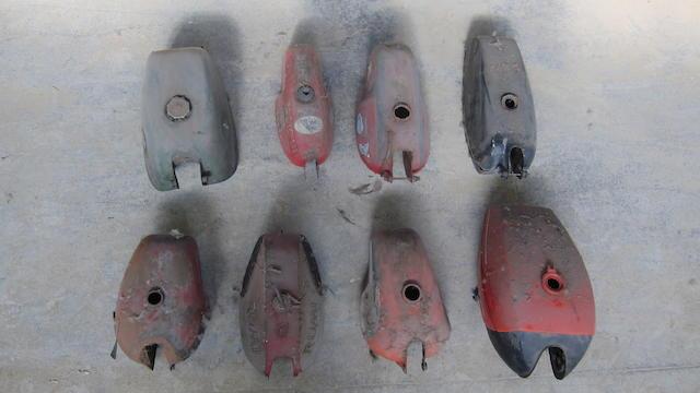 A quantity of petrol tanks  ((8))