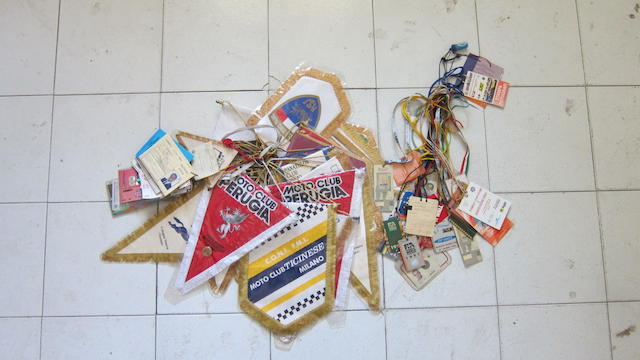 A large quantity of paddock passes and pennants  ((Qty))