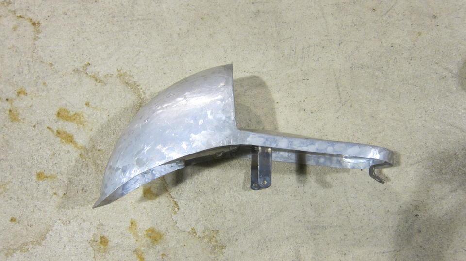 An aluminium alloy racing petrol tank  ((2))