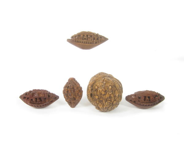 A small collection of carved peach stones and walnut shells 19th century (7)