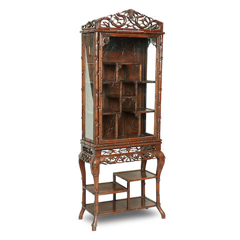 A hongmu faux-bamboo tall display cabinet on stand 19th century