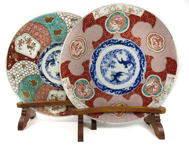 A matched pair of Imari chargers on wooden stands Late 19th century (4)