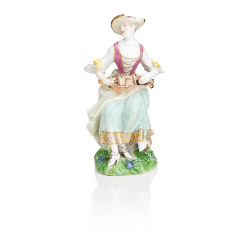 A Meissen figure of a lady playing the hurdy-gurdy 18th century