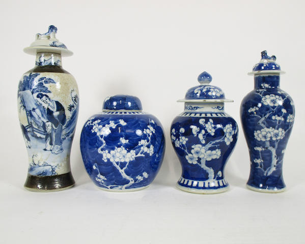 Three blue and white prunus-decorated vases with covers and a crackle ware example Circa 1900 (8)