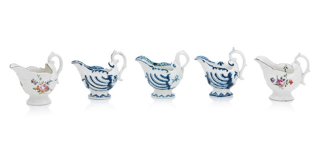 Four Derby porcelain dolphin ewer creamboats and a Worcester example Late 18th century