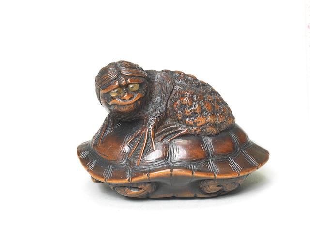 A wood netsuke of a kappa on a tortoise By Naito Toyomasa (1773-1856), Tanba Province, early 19th century