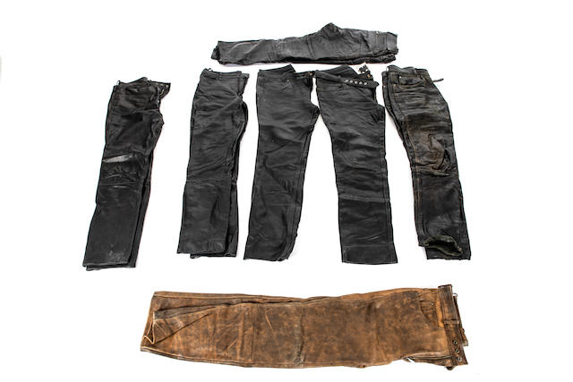 Seven pairs of mostly black leather riders trousers  ((7))