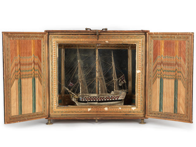 A Napoleonic prisoner-of-war bone model of the 100-gun ship-of-the-line HMS Royal Sovereign of the Seas,  early 19th century,  10in x 11in x 3in (25.5cm x 28cm x 7.5cm), the case 12in x 13 1/2in x 6in (30.5cm x 34.5cm x 15cm)