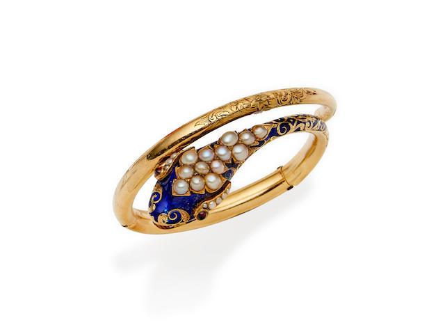 An enamel, seed pearl and garnet snake bangle