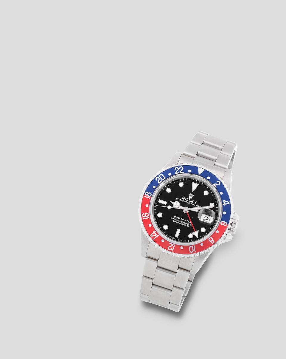 Rolex. A stainless steel automatic calendar bracelet watch with dual time zone  GMT Master 'Pepsi', Ref: 16700, Circa 1988
