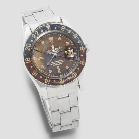 Rolex. A fine stainless steel automatic calendar dual time wristwatch with bakelite bezel  GMT Master, Ref: 6542, Circa 1959