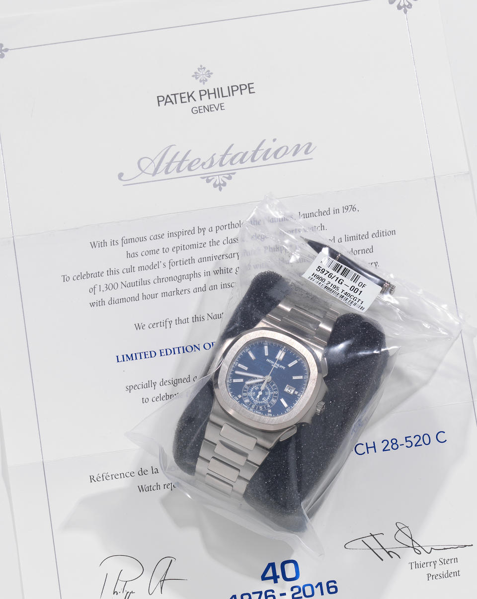 Patek Philippe. A very fine and rare factory sealed Limited Edition Anniversary 18K white gold automatic calendar flyback chronograph bracelet watch with diamond set dial  40th Anniversary Nautilus, Ref: 5976/1G-001, Purchased 12th June 2017