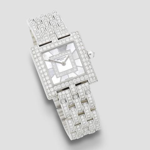 Patek Philippe. A lady's fine 18K white gold, diamond set and mother of pearl quartz bracelet watch  Gondolo, Ref: 4874/1, Circa 2000