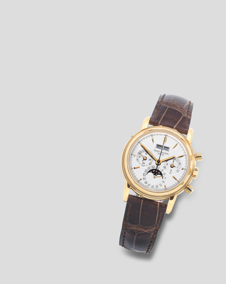 Patek Philippe. A fine 18K gold manual wind perpetual calendar chronograph wristwatch with moon phase Ref: 3970EJ-014, Purchased 5th September 2003