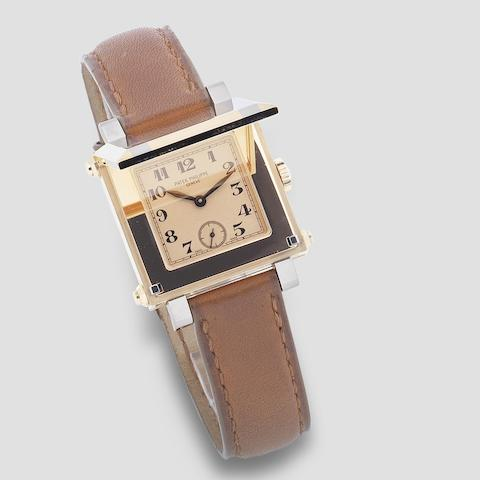 Patek Philippe. An unusual 18K two colour gold manual wind square form wristwatch with concealed dial  Gondolo Cabriolet, Ref: 5099RG-001, Purchased 17th May 2004