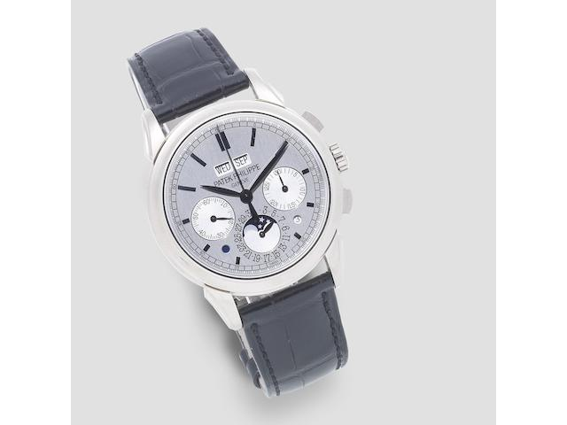 Patek Philippe. A fine and rare 18K white gold manual wind perpetual calendar chronograph wristwatch with moon phase Ref: 5270G-001, Purchased 12th March 2013