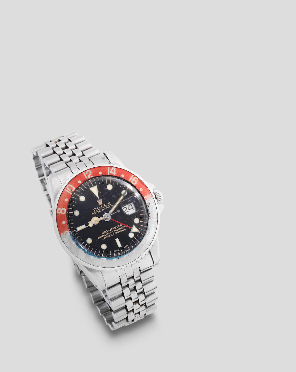 Rolex. A stainless steel automatic calendar bracelet watch with dual time zone and gilt dial  GMT Master, Ref: 1675, Circa 1964