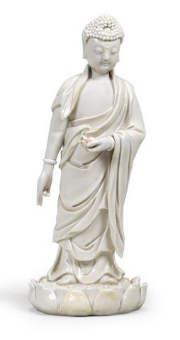A BLANC-DE-CHINE FIGURE OF BUDDHA AMITABHA