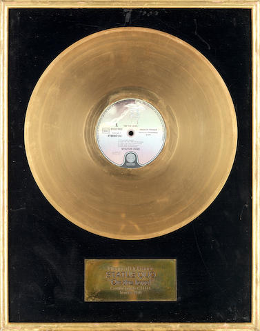 Status Quo: A French 'Gold' disc award for the 1975 album On The Level,