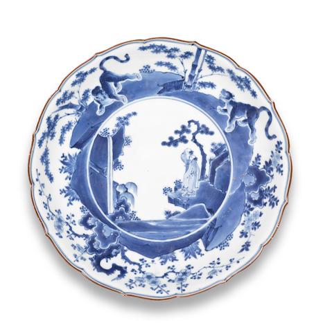A blue-and-white kakiemon-style large flori-rimmed dish  Edo period (1615-1868), circa 1700 (2)