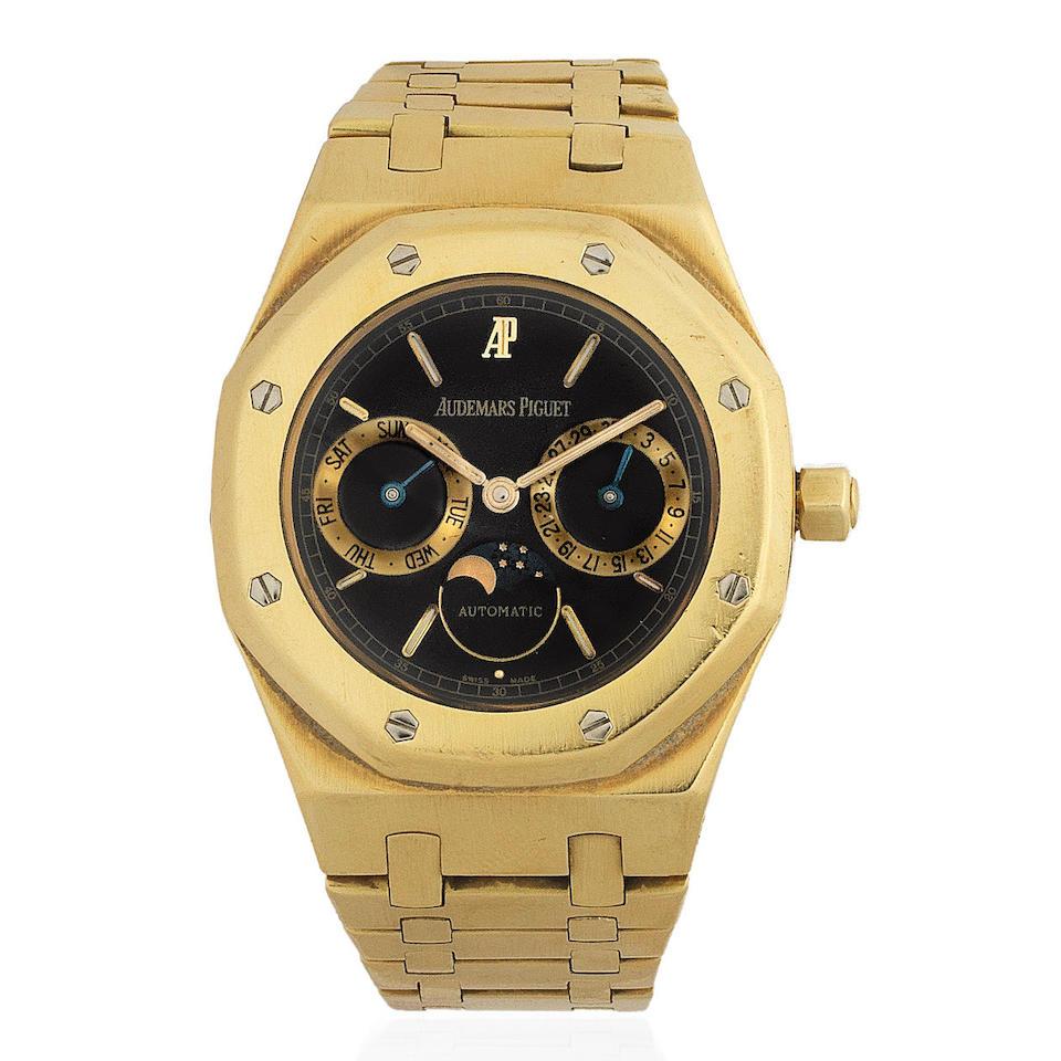 Audemars Piguet. An 18K gold automatic calendar bracelet with moon phase  Royal Oak, Ref: 25594, Circa 1997