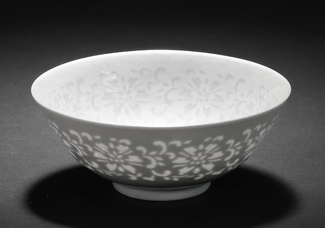 A very rare white glazed 'cut-through' 'lotus' bowl Qianlong seal mark and of the period