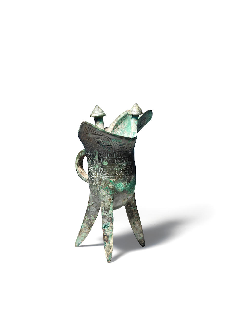A rare bronze inscribed ritual tripod wine vessel, jue Late Shang/early Western Zhou Dynasty, 12th-10th century BC