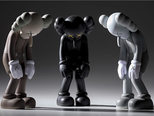 KAWS (American, born 1974) Small Lie (Brown); Small Lie (Black); Small Lie (Grey) Set of three multiples, 2017, painted vinyl housed in original Medicom packaging, each printed with the artist's name, date, fabricator and title 'KAWS..17 SMALL LIE MEDICOM TOY CHINA' on the underside, fabricated by Medicom Toy, Japan, each 129 x 122 x 275mm (5 1/8 x 4 7/8 x 10 7/8in)(3)