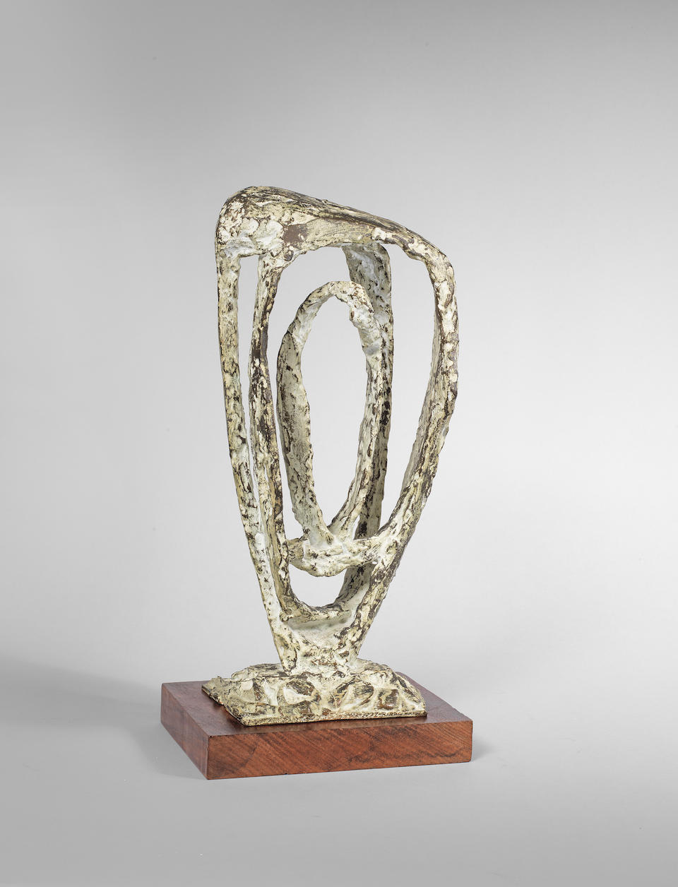 Dame Barbara Hepworth (British, 1903-1975) Maquette (Variation on a Theme) 43.8 cm. (17 1/4 in.) high (excluding the wooden base) (Conceived in 1958, the present work is number 2 from the edition of 9)