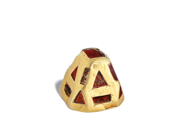 An Anglo-Saxon gold and garnet pyramidal mount